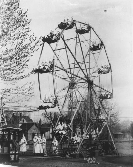KKK members riding a ferris wheel