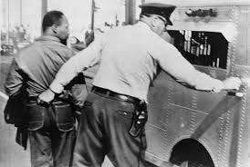Photograph of Martin Luther King Jr. getting arrested