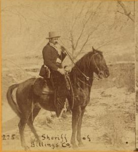 Sepia photo of a man on horseback with the caption,