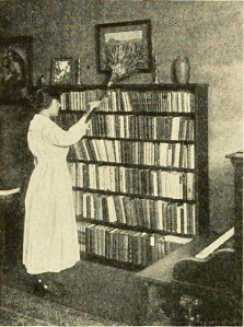 Woman dusting bookshelves